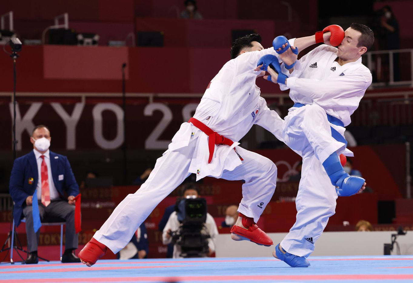 USA's Tom Scott is hit in the face by Japan's Ken Nishimura during the karate men's kumite -75kg elimination round at the postponed 2020 Tokyo Olympics at Nippon Budokan, on Friday, August 6, 2021, in Tokyo, Japan. Nishimura defeated Scott 2-0. Scott finished in fourth place in his pool and did not advance to the next round. (Vernon Bryant/The Dallas Morning News)