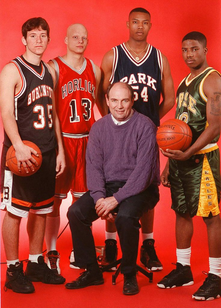 The 1998 Racine County (WI) All-County boys' basketball team is from left, Tony Romo, Burlington, Shane Krause, Horlick, coach of the year, Jeff Christensen, Lutheran, Caron Butler, player of the year, Park, and Taron Barker, Case. April 12, 1998. (Liana J. Cooper/Racine Journal Times)