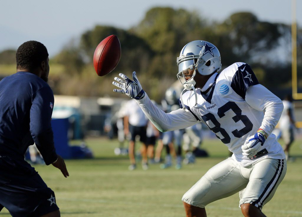 Dallas Cowboys wide receiver Terrance Williams (83) works on his ball handling skills by tapping it back and forth with a coach following afternoon practice at training camp in Oxnard, California, Tuesday, August 9, 2016. (Tom Fox/The Dallas Morning News)