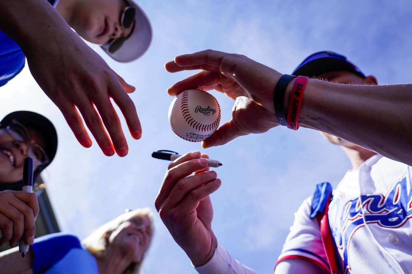 Rangers outfielder Scott Heineman signed autographs before an exhibition game against the Chicago Cubs at Surprise Stadium in late February in Surprise, Ariz.