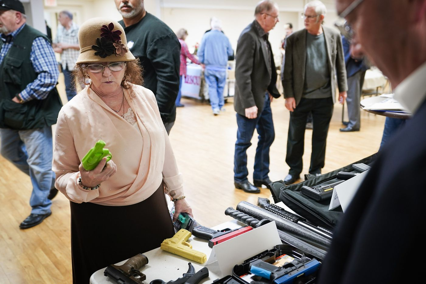 Sharon Bascom, of Quinlan, Texas, checks out a training weapon displayed by Sentry One Consulting Group at during a  church safety seminar at North Pointe Baptist Church on Sunday, Jan. 26, 2020, in Hurst, Texas.