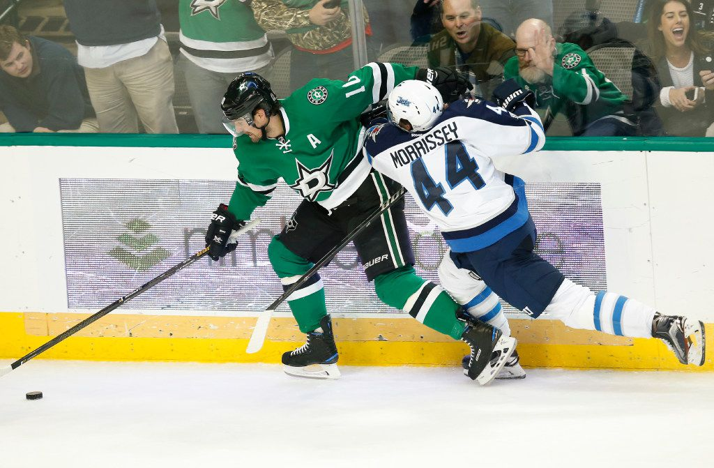 Dallas Stars left wing Patrick Sharp (10) and Winnipeg Jets defenseman Josh Morrissey (44) compete for the puck during the third period of an NHL hockey game, Thursday, Feb. 2, 2017, in Dallas. The Jets won 4-3. (AP Photo/Jim Cowsert)