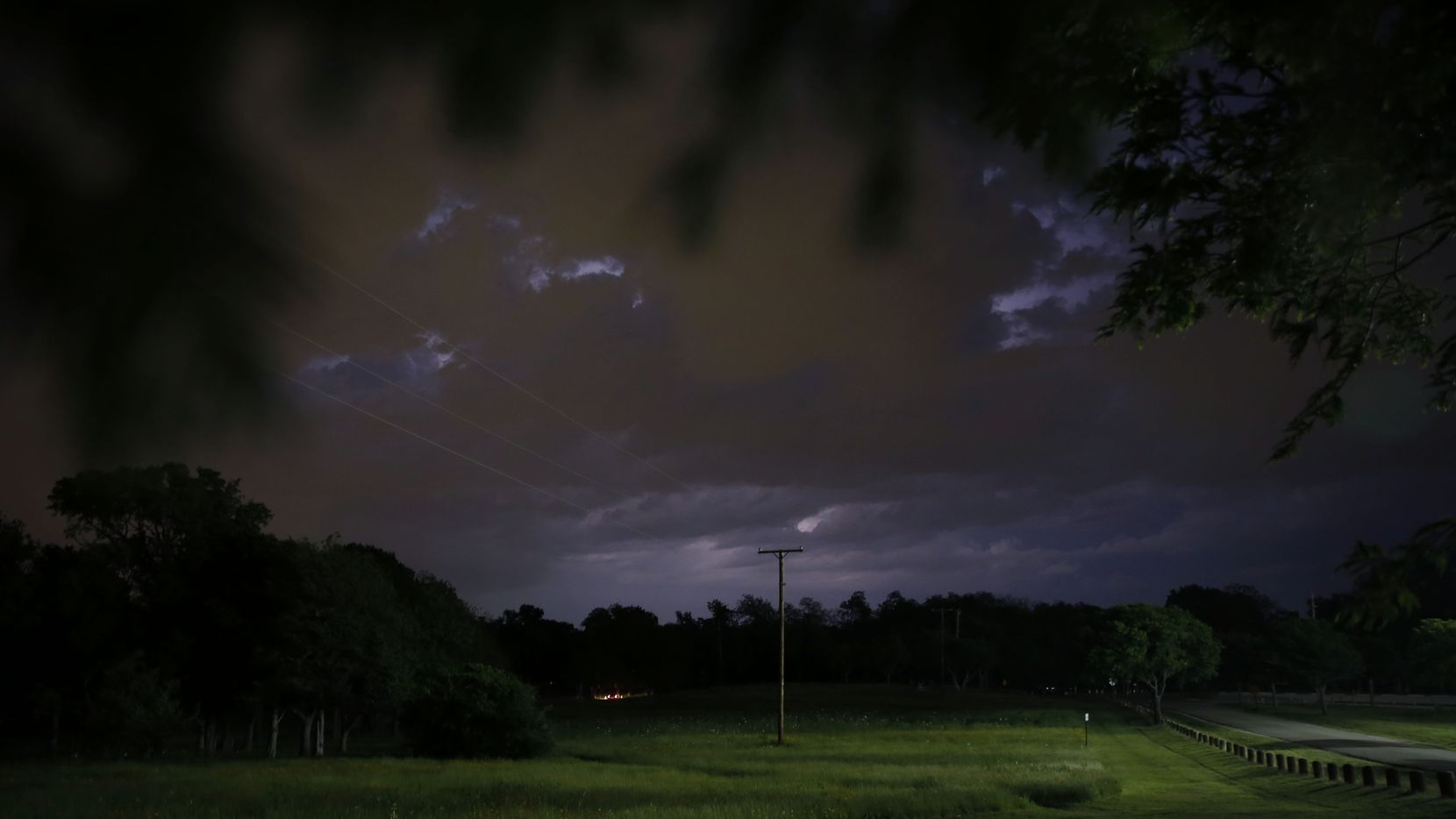 An April lightning storm is seen to from Winfrey Point near White Rock Lake.