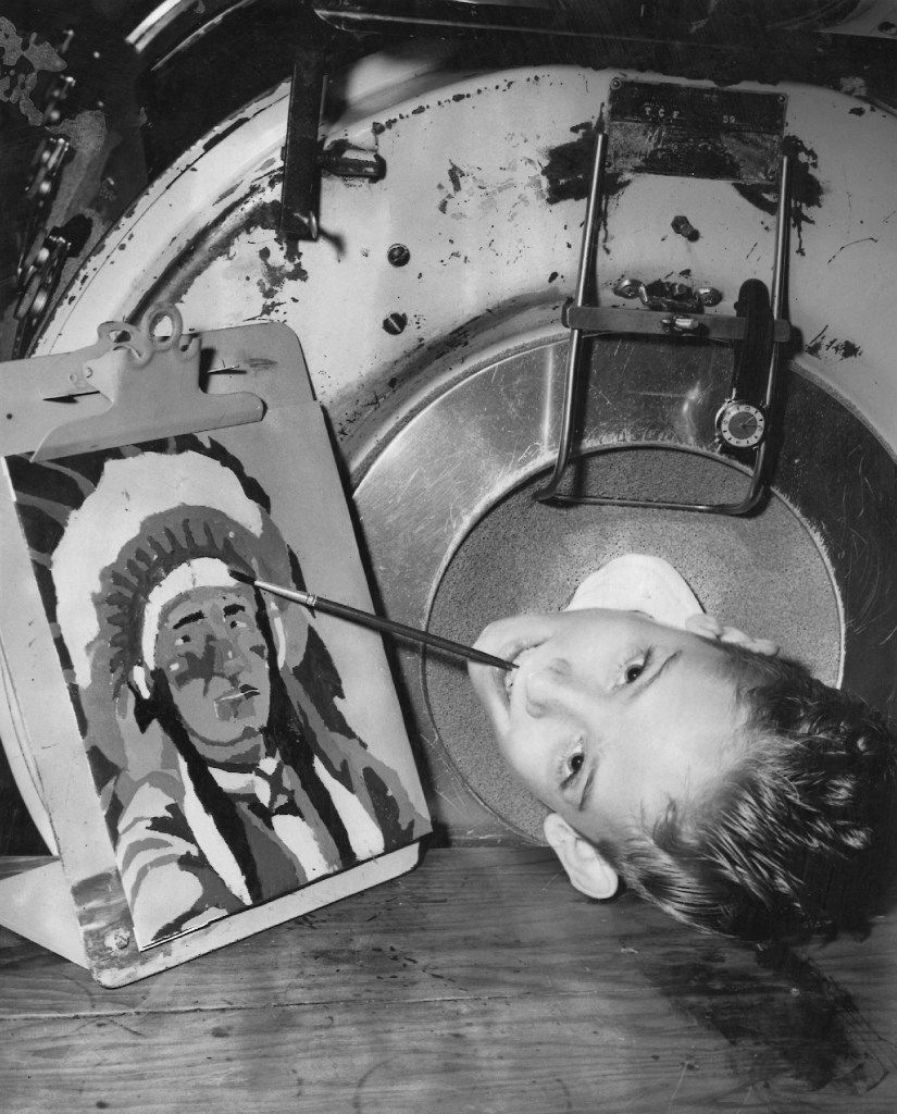 """Paul Richard Alexander, 9, was struck with polio right before he began elementary school in 1952. He is shown in August 1955. """"I like to paint, go on picnics and go to church,"""" said the boy, who has no use of his limbs."""
