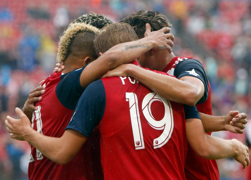 FC Dallas midfielder Michael Barrios (21), left, became an impromptu honoree of a hug club including Paxton Pomykal (19) and other teammates celebrating his goal during first half action against Colorado Rapids. The two teams played their Major League Soccer game at Toyota Stadium in Frisco on March 23, 2019. (Steve Hamm/ Special Contributor)