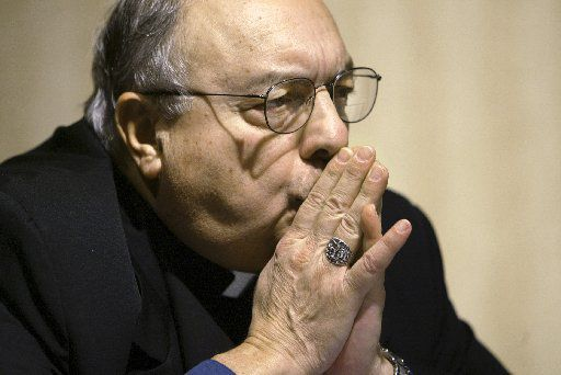 Bishop Joseph A. Galante of Dallas, Texas listens intently as he participates on a panel of bishops taking questions from reporters at the U.S. Conference of Catholic Bishops meeting in Washington in 2003.