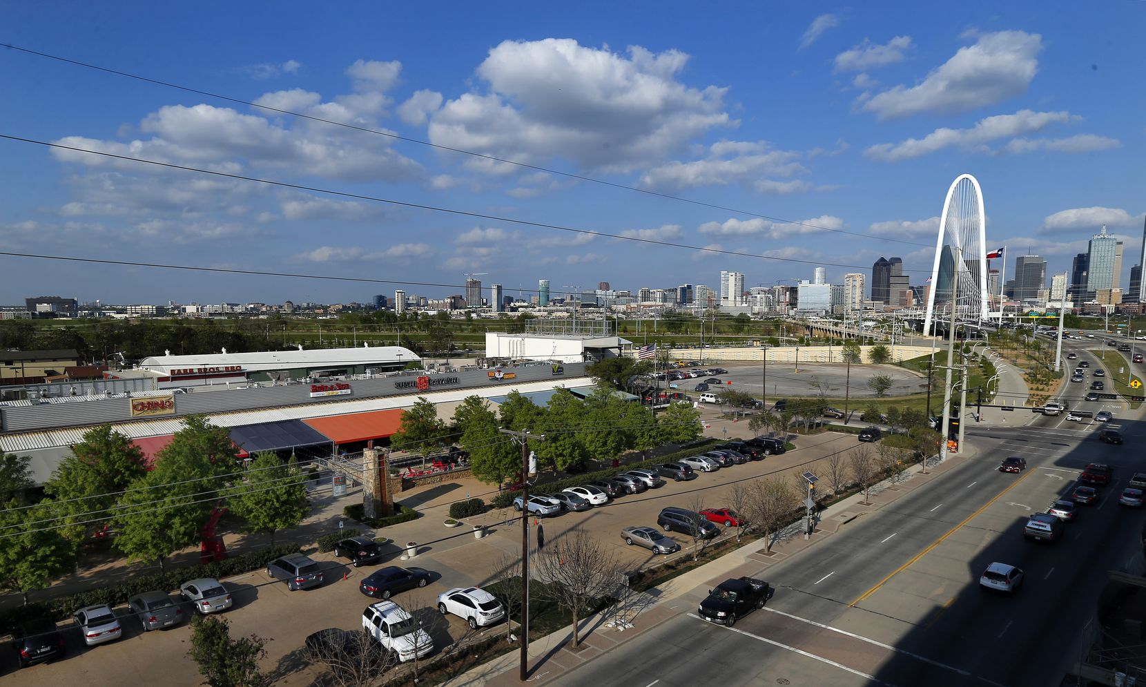 The new beer garden will be built where the parking lot is, in front of Trinity Groves.