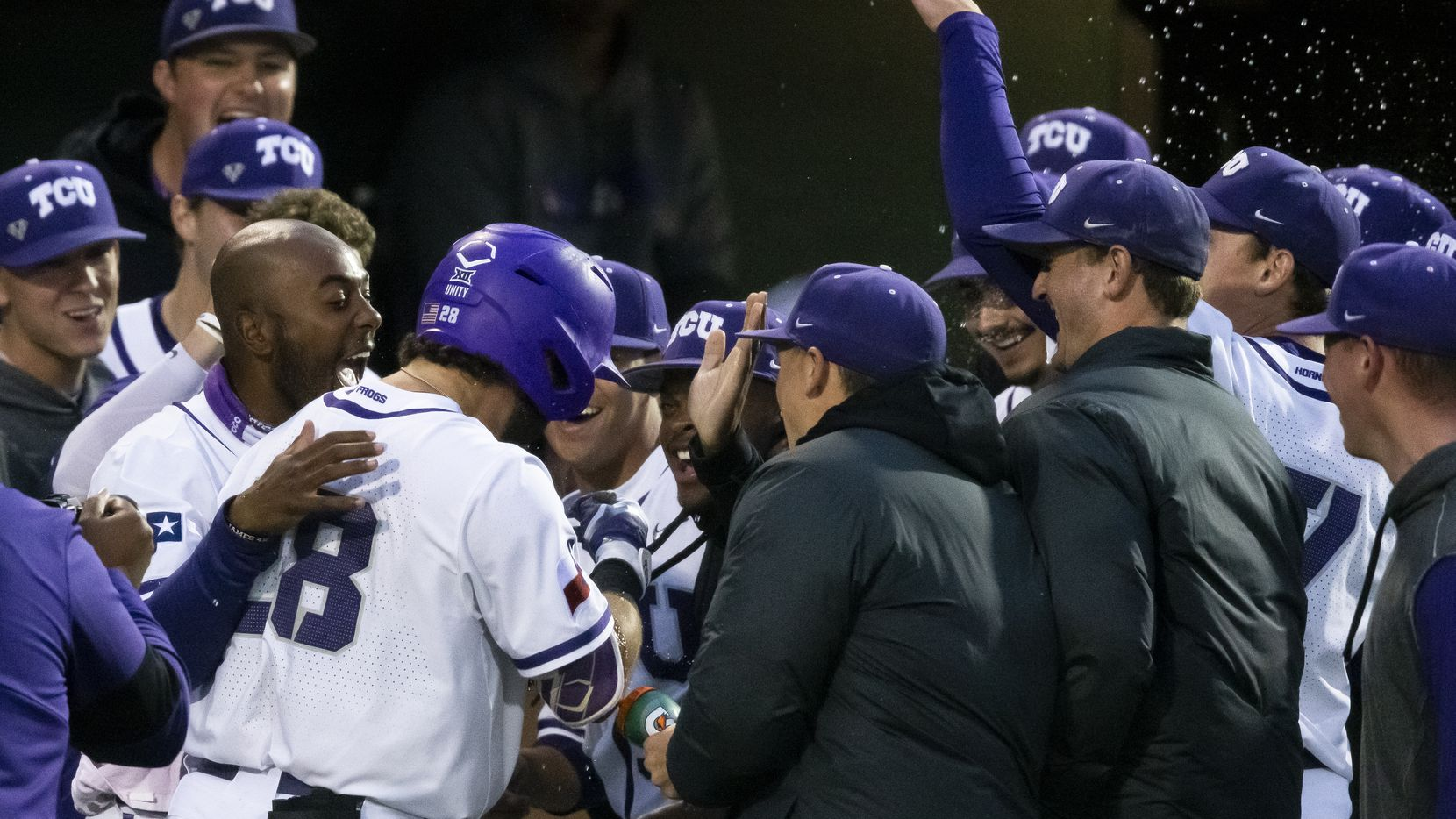 TCU Gray Rodgers (28) is congratulated by teammates after hitting a two-run home run during the second inning of an NCAA baseball game against Oklahoma St. on Friday, April 16, 2021, in Fort Worth, Texas.