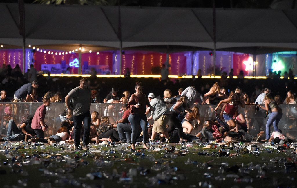Chaos engulfed the Route 91 Harvest country music festival in Las Vegas after gunfire erupted.