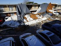 The roof of a Waterdance Apartments building was peeled off by a tornado-warned storm Tuesday night and landed on residents cars in the parking lot. Damage also occurred at The Mirage Apartments along Pioneer Parkway in Arlington, Wednesday, November 24, 2020. (Tom Fox/The Dallas Morning News)