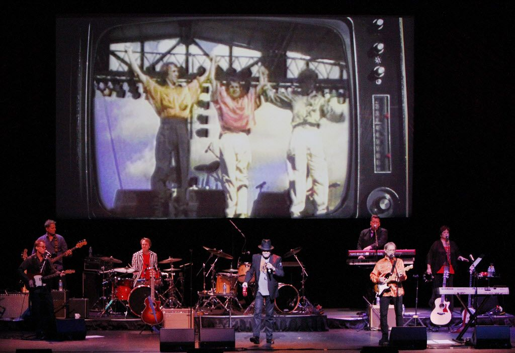 A large screen displays video images of the musical group The Monkees during their performance, on Tuesday, June 28, 2015 at the Winspear Opera House in Downtown Dallas. Ben Torres/Special Contributor
