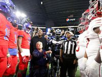 Texas State Govenor Greg Abbott flips the coin before Duncanville's game with Galena Park North Shore during the Class 6A Division I football state championship game at AT&T Stadium in Arlington, Texas on Dec 22, 2018.