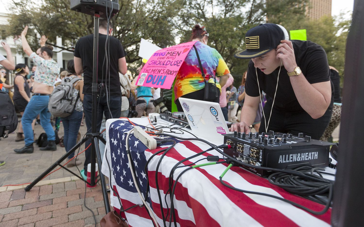 Ezra Edwards, DJ Girlfriend, plays music during a dance party supporting the LGBTQ community gathered in front of the Governor's Mansion in Austin on Thursday, Feb. 23, 2017.