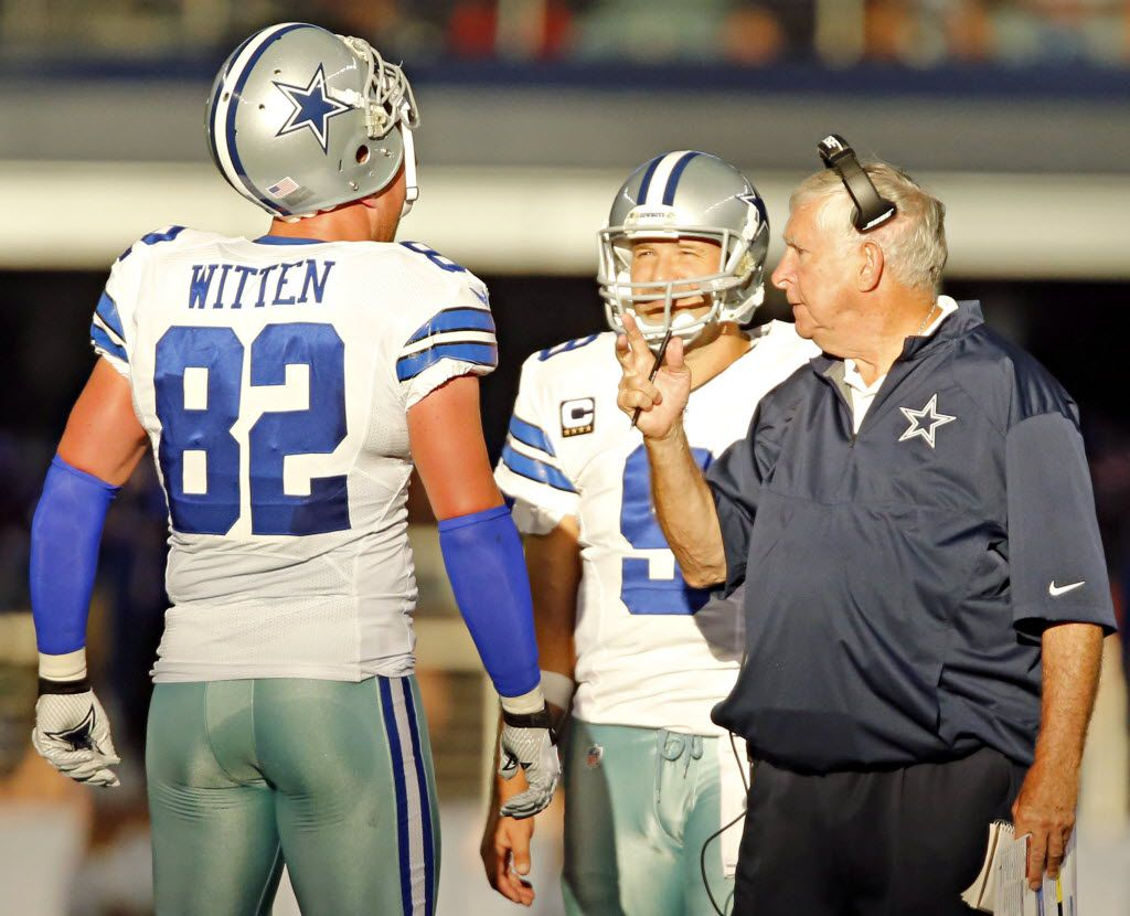 Dallas Cowboys quarterback Tony Romo (9) looks on as tight ends coach Mike Pope (right) talks with Jason Witten during the second half of Dallas' 31-21 win over the New York Giants Sunday, October 19, 2014 at AT&T Stadium in Arlington, Texas. (G.J. McCarthy/The Dallas Morning News)