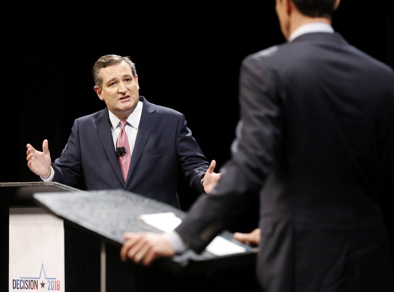 Sen. Ted Cruz (R-TX) turns toward Rep. Beto O'Rourke (D-TX) to make a point during a debate at McFarlin Auditorium at SMU in Dallas, on  Friday, September 21, 2018.