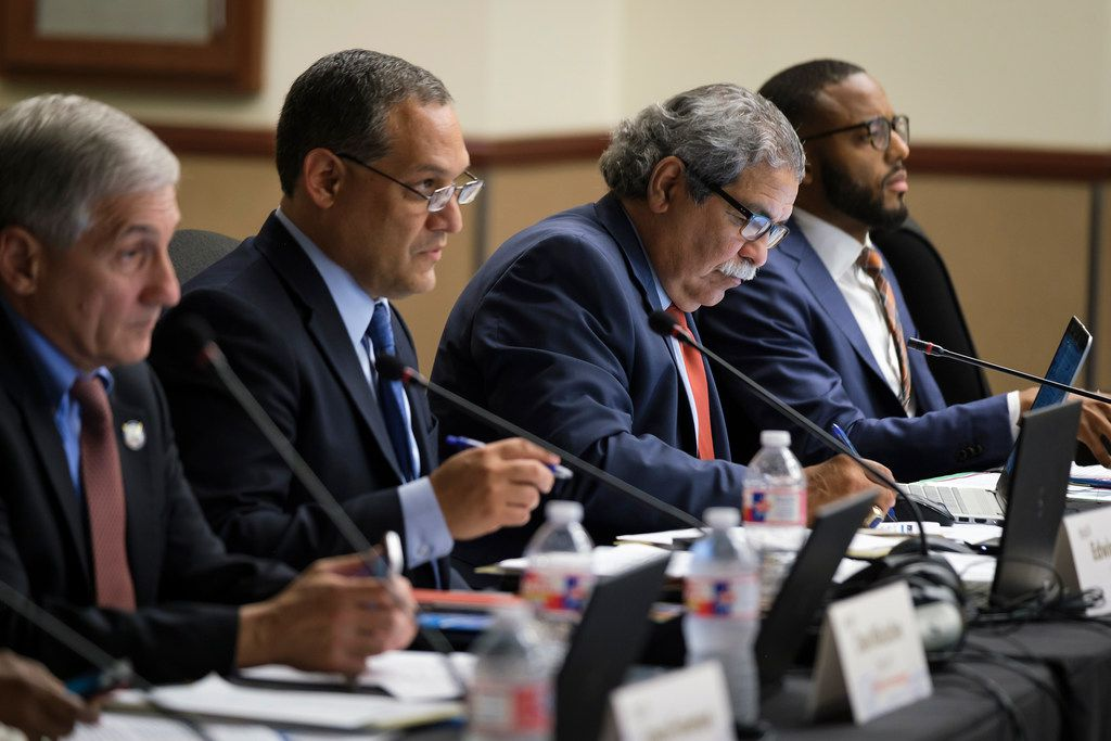 From left, DISD trustees Dan Micciche and  Edwin Flores, Superintendent Michael Hinojosa and trustee Justin Henry participate in a board meeting on May 23, 2019, in Dallas.