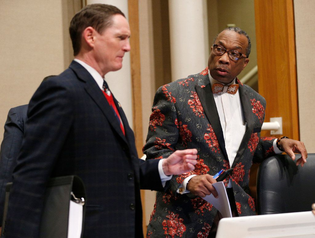 County Judge Clay Jenkins with County Commissioner John Wiley Price after a commissioners court meeting in Dallas on December 20, 2016. (Nathan Hunsinger/The Dallas Morning News)