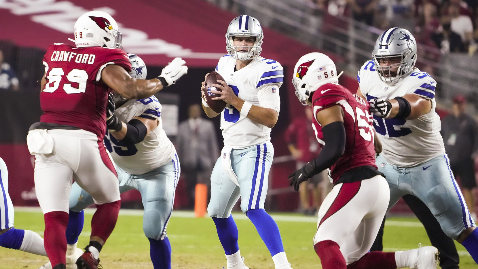 Dallas Cowboys quarterback Garrett Gilbert (3) looks to pass as tackle Brandon Knight (69) and guard Connor Williams (52) provide protection during the first quarter of an NFL football game against the Arizona Cardinals at State Farm Stadium on Friday, Aug. 13, 2021, in Glendale, Ariz. (Smiley N. Pool/The Dallas Morning News)