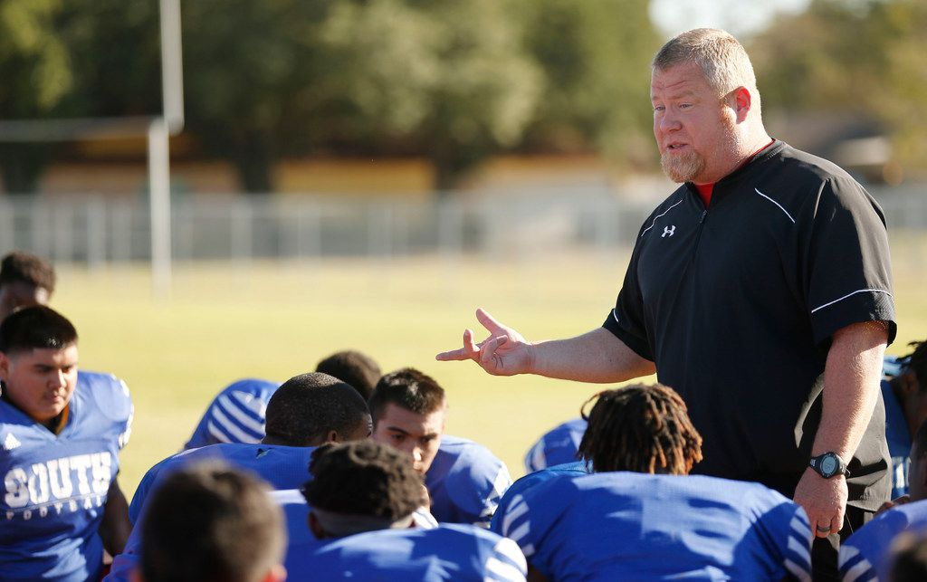 South Garland's head football coach Josh Ragsdale talks to his players after practice at South Garland High School in Garland, Texas on Wednesday, October 25, 2017. Coach Ragsdale started a program helping to educate players about domestic violence at the school. (Vernon Bryant/The Dallas Morning News)