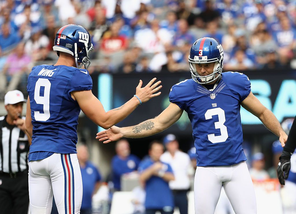 EAST RUTHERFORD, NJ - SEPTEMBER 18:  Josh Brown #3 of the New York Giants celebrates kicking a field goal with teammate Brad Wing #9 in the third quarter against the New Orleans Saints during the second half at MetLife Stadium on September 18, 2016 in East Rutherford, New Jersey.  (Photo by Elsa/Getty Images)