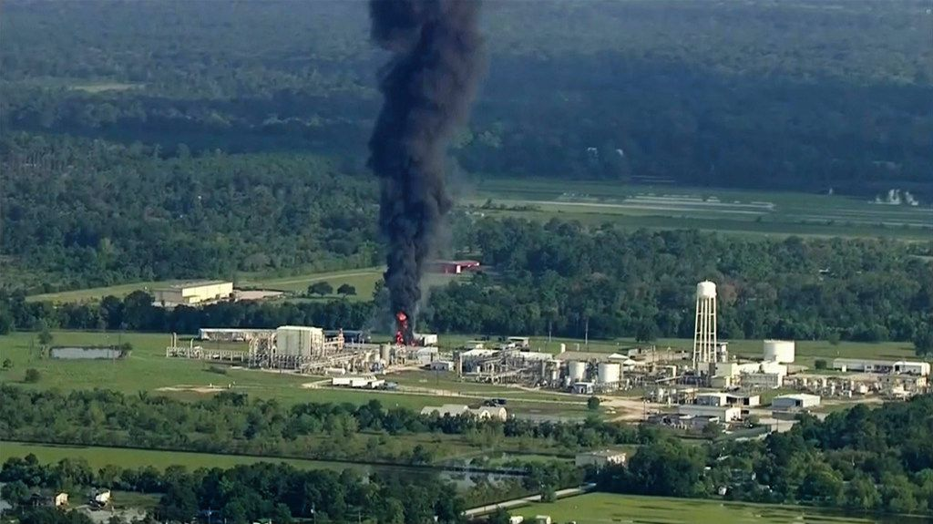 Smoke rises from a chemical plant in Crosby, near Houston. Nearly 20 Houston-area residents say test have detected toxic substances in soil, water and ash samples taken miles from the chemical plant that flooded during Hurricane Harvey, caught fire and partially exploded.
