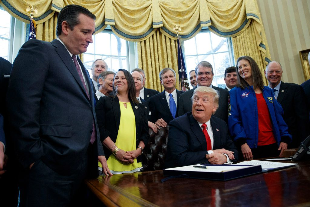 President Donald Trump jokes with Sen. Ted Cruz, R-Texas, during a signing ceremony in the Oval Office of the White House in March.