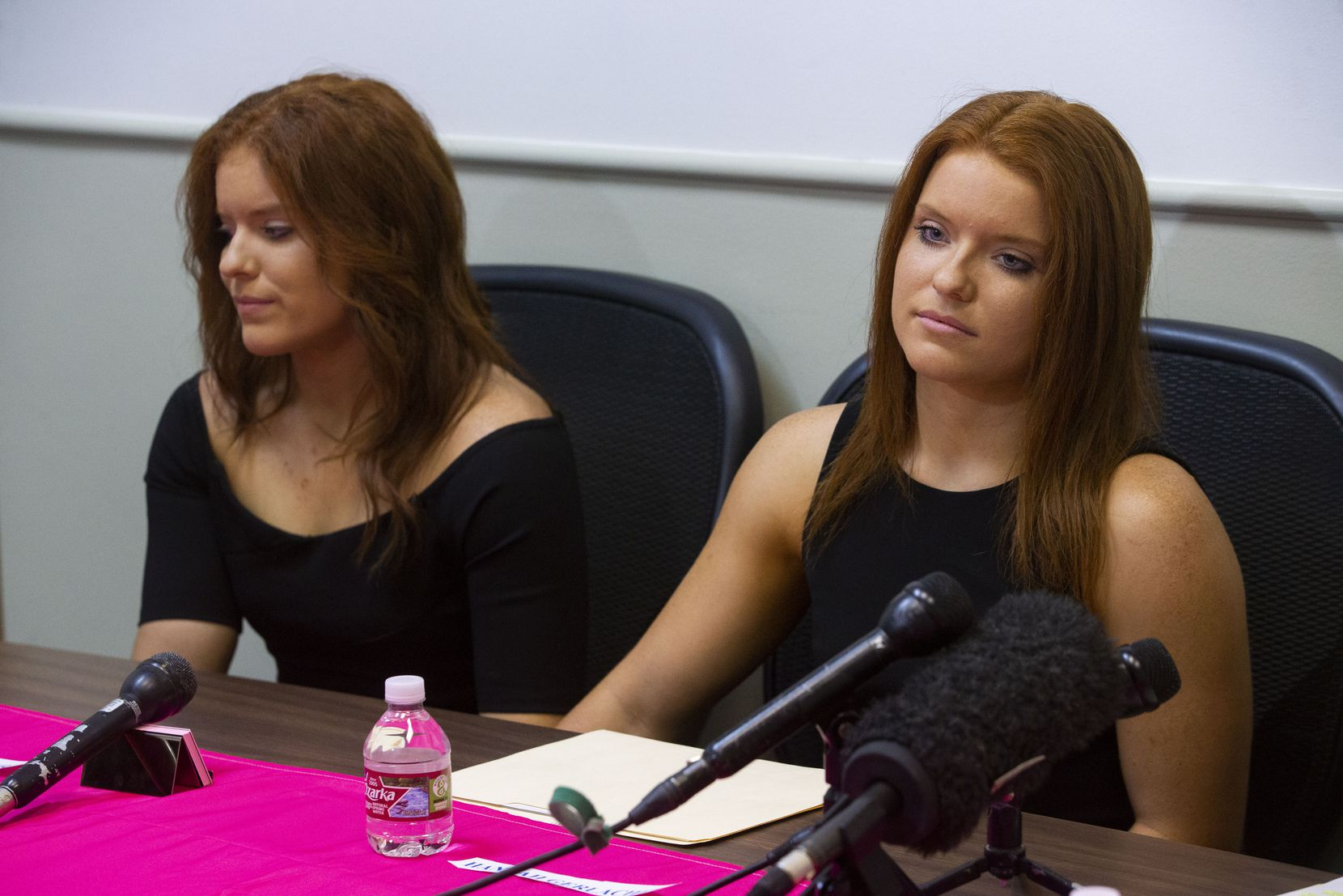 """Sisters Jessica, left, and Hannah Gerlacher listen during a Monday morning news conference. Hannah Gerlacher said, """"We love the children that we coach more than anything, and we wouldn't want anything like this to happen to them."""""""