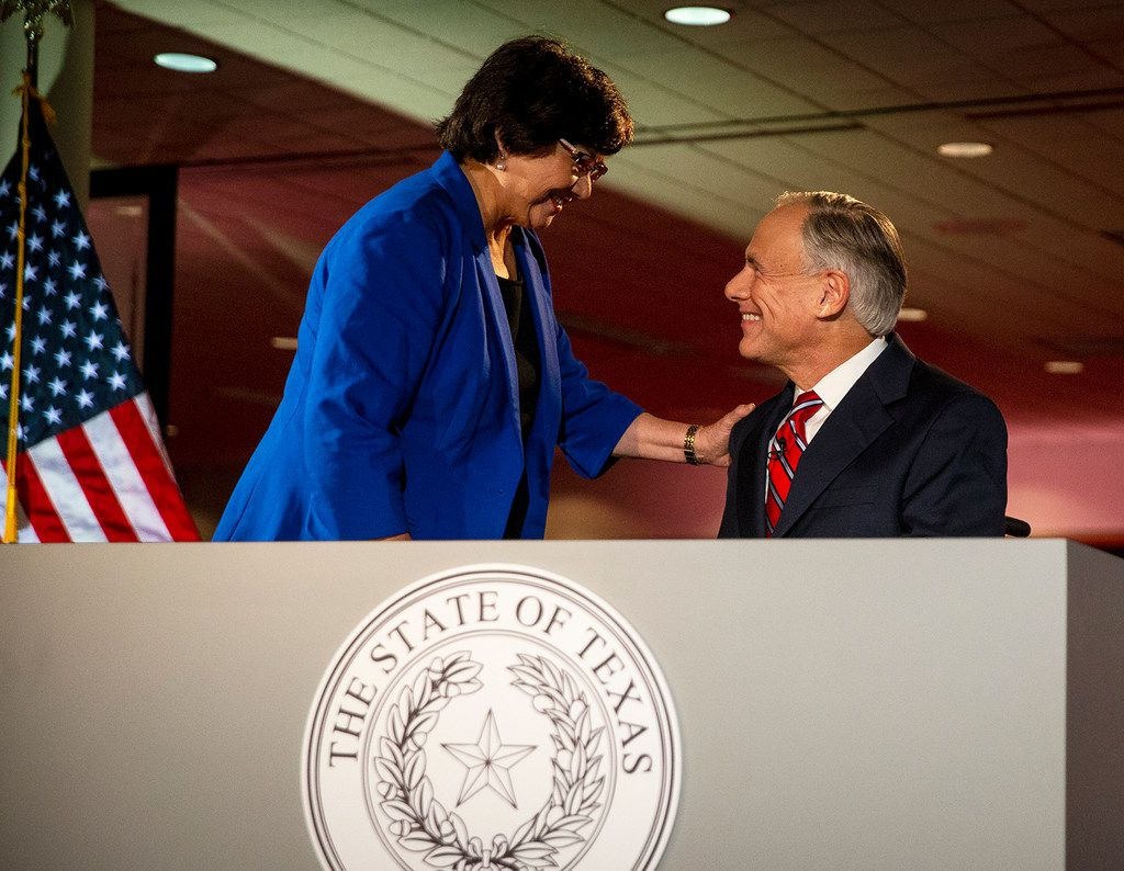 Texas Governor Greg Abbott, right, and his Democratic challenger, Lupe Valdez, greet each other before a gubernatorial debate prior to a debate at the LBJ Library in Austin, Texas, on Friday, Sept. 28, 2018.  (Nick Wagner/Austin American-Statesman via AP, Pool)