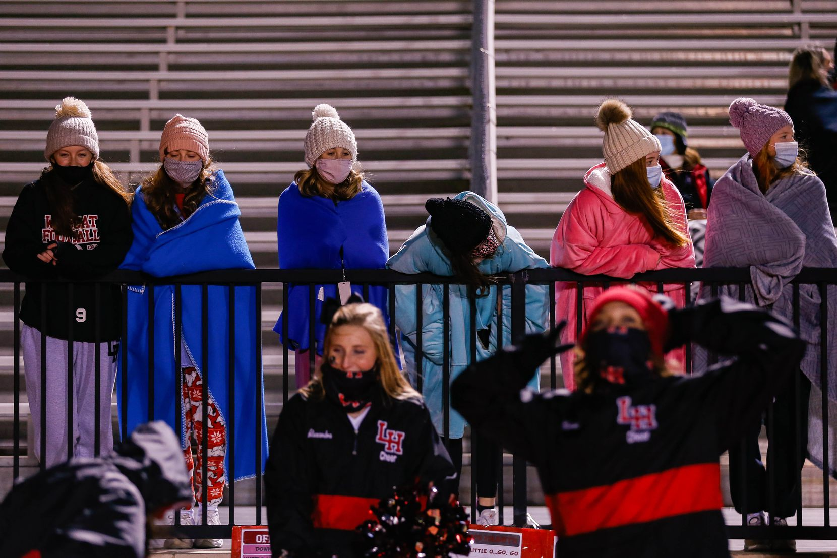 Lake Highlands' fans bundle up as they watch during a the second quarter of a high school football game against  Irving MacArthur at Joy & Ralph Ellis Stadium in Irving on Friday, Oct. 23, 2020. (Juan Figueroa/ The Dallas Morning News)