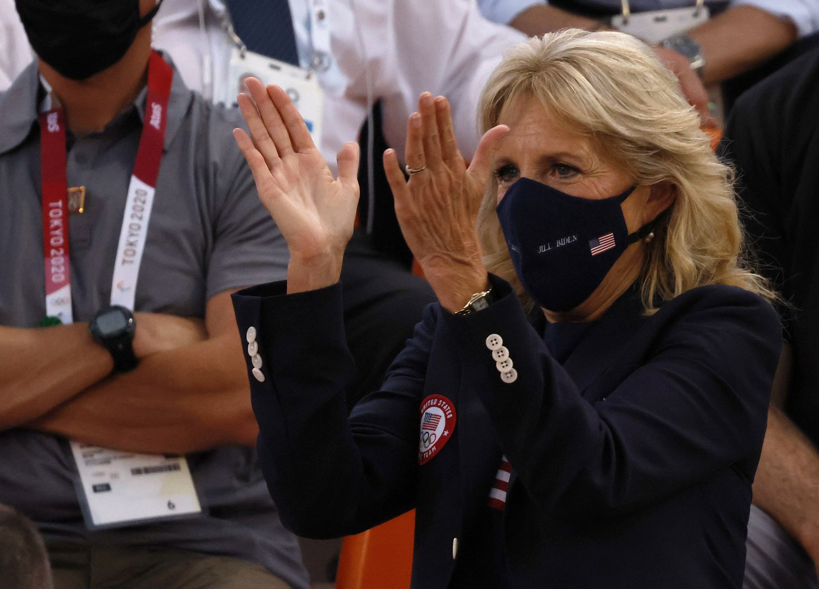 First lady Jill Biden celebrates a victory for USA over France 17-10 in a 3x3 women's basketball game during the postponed 2020 Tokyo Olympics at Aomi Urban Sports Park on Saturday, July 24, 2021, in Tokyo, Japan. (Vernon Bryant/The Dallas Morning News)