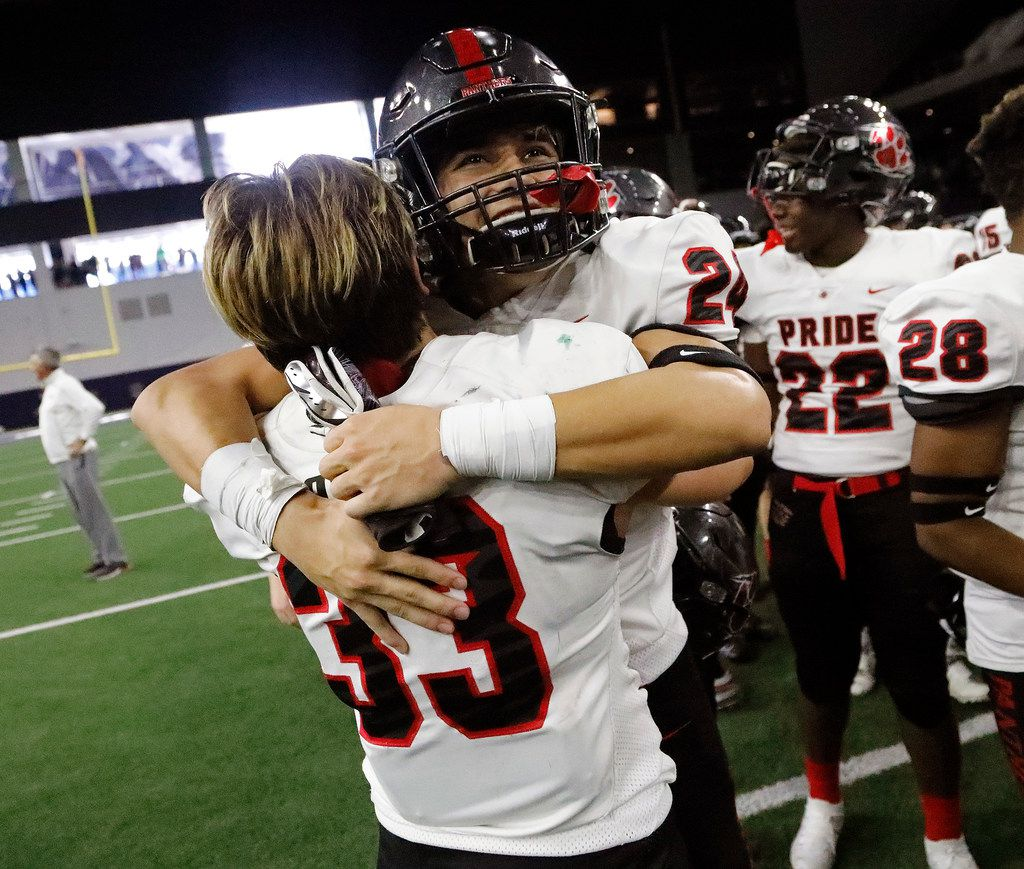 Colleyville Heritage High School linebacker Matthew Powers (33) embraces Colleyville Heritage High School cornerback Michael Neves (24) as they celebrate their victory over Birdville High School in a Class 5A Division I, Region I semifinal game at The Star in Frisco on Saturday, November 30, 2019. (Stewart F. House/Special Contributor)