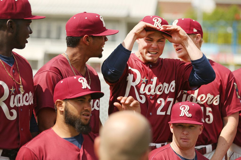 Frisco RoughRiders outfielder Scott Heineman (27) jokes around before taking a team photograph during Frisco RoughRiders media day at Dr Pepper Ballpark in Frisco, Texas Tuesday April 3, 3018. Frisco starts its season against Tulsa on Thursday April 5. (Andy Jacobsohn/The Dallas Morning News)