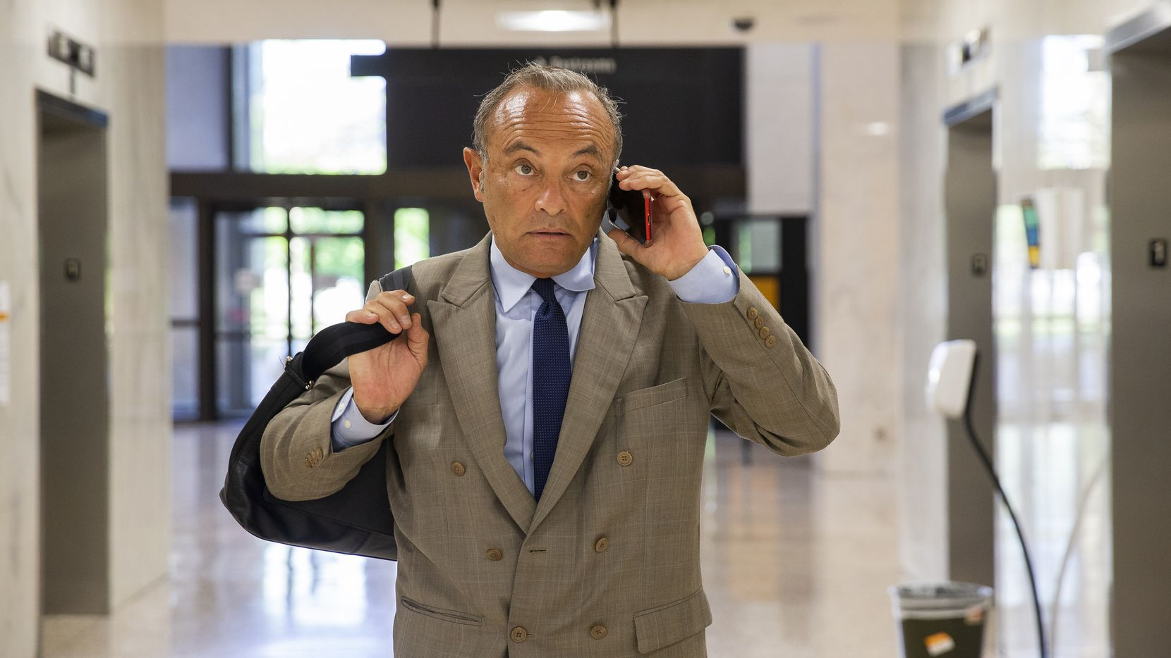 Immigration attorney Fernando Dubove talks to a client after filing court documents in a nearly empty Earle Cabell Federal Building Thursday morning on March 26, 2020 in Dallas.