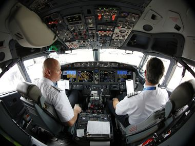 American Airlines Captain Pete Gamble (left) and First Officer John Konstanzer perform a pre-flight check of their Boeing 737 Max aircraft before taking off from DFW International Airport en route to Tulsa on Wednesday.