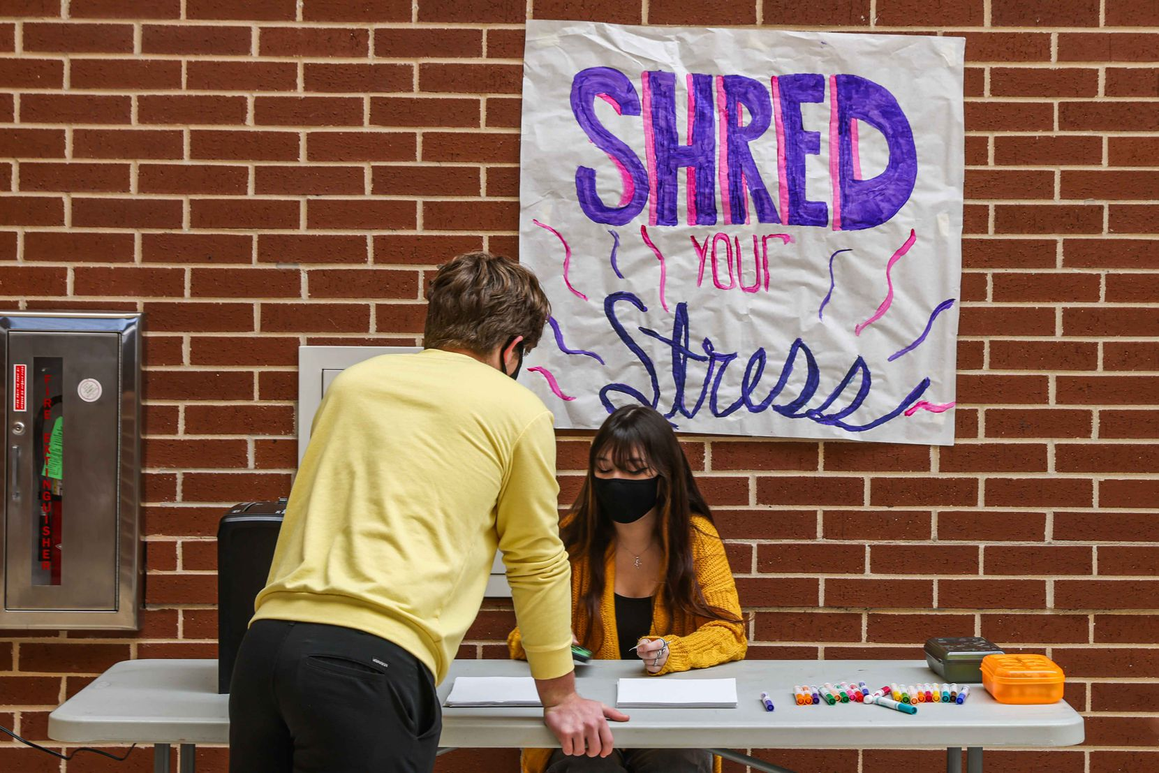 "Hope Squad members Sam Simonini and Annalee Jackson worked the ""Shred Your Stress"" table just outside the Prosper High School cafeteria Wednesday. Hope Squad has posted mental wellness and suicide prevention information throughout the school and regularly schedules activities focused on awareness."