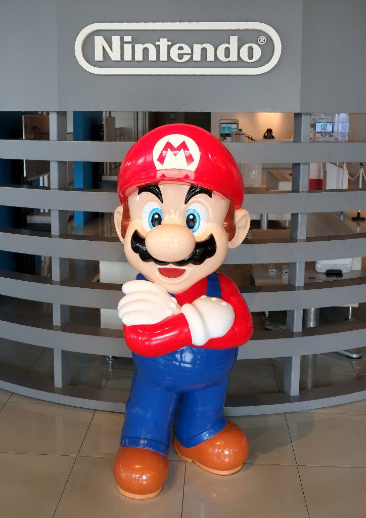 The logo of Japanese gaming giant Nintendo and its game character Super Mario on display at a showroom in Tokyo.