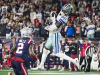 Dallas Cowboys wide receiver CeeDee Lamb (88) catches a 24-yard pass on a 3rd-and-25 play past New England Patriots cornerback Jalen Mills (2) to set up a field goal to tie the game with under a minute left to play during the second half of an NFL football game on Sunday, Oct. 17, 2021, in Foxborough, Mass.
