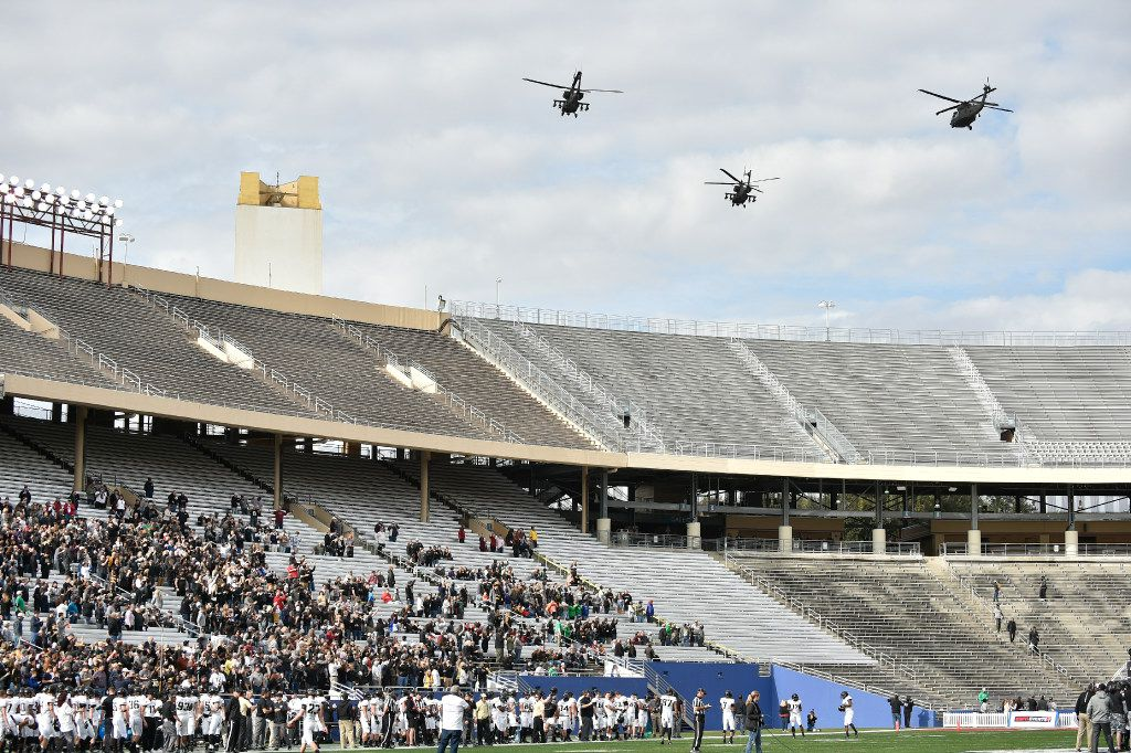 Helicopters fly over the Cotton Bowl before the start of the Heart of Dallas Bowl on December 27, 2016.