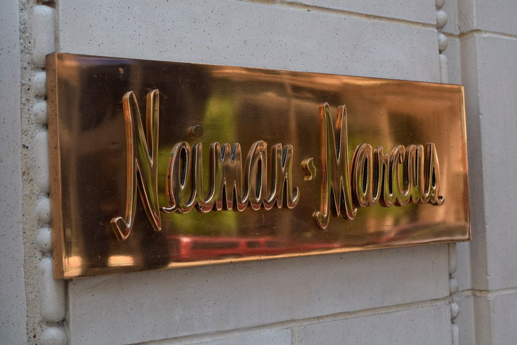 This May 12, 2016 photo shows a Neiman Marcus nameplate outside the department store in downtown Dallas. (John Lumpkin via AP)