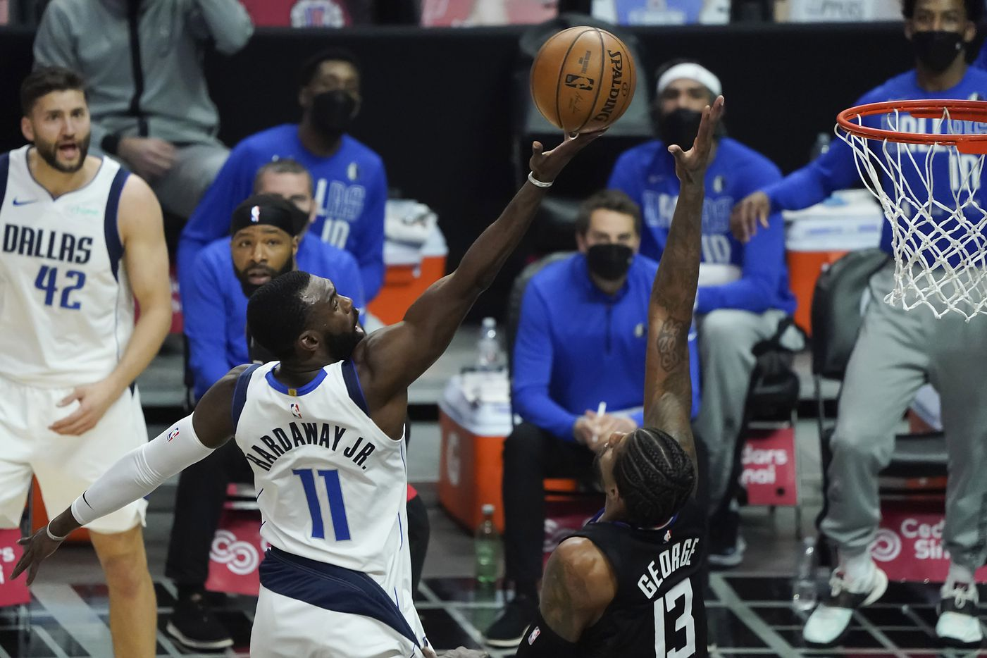 Dallas Mavericks forward Tim Hardaway Jr. (11) has a shot blocked by LA Clippers guard Paul George (13) during the first half of an NBA playoff basketball game at Staples Center on Tuesday, May 25, 2021, in Los Angeles.
