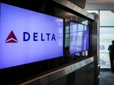 A man looks out from a Delta Airlines gate at Houston Hobby Airport on Friday, March 20, 2020, in Houston.