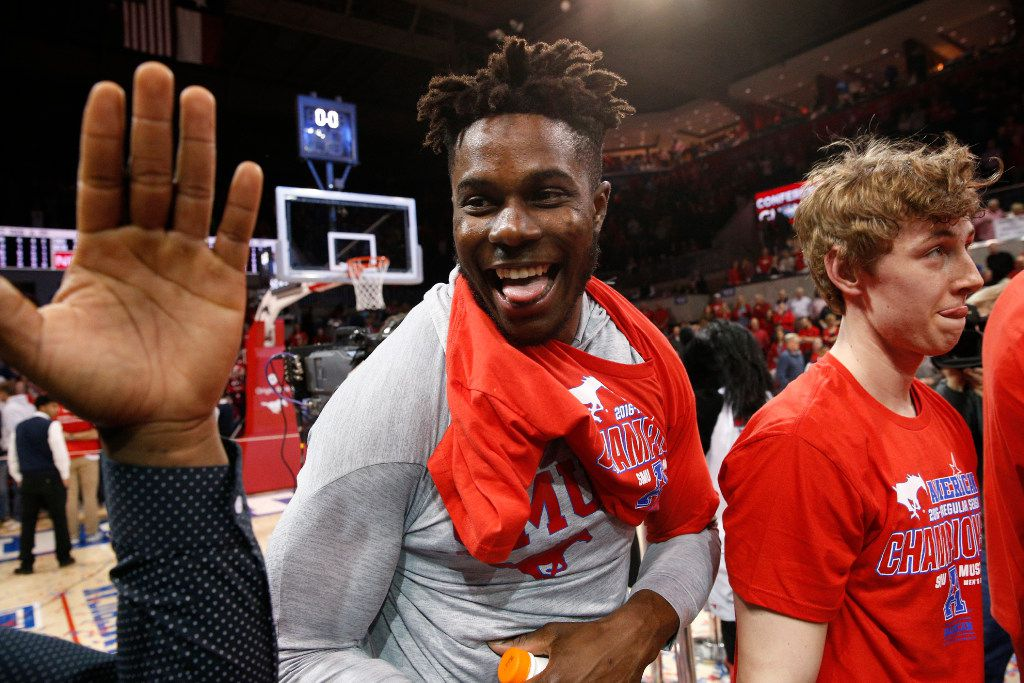 Southern Methodist Mustangs forward Semi Ojeleye (33) and his teammates celebrate winning the American Athletic Conference regular season conference title at Moody Coliseum in Dallas on March 4, 2017 by beating Memphis by a score of 103-62. (Nathan Hunsinger/The Dallas Morning News)