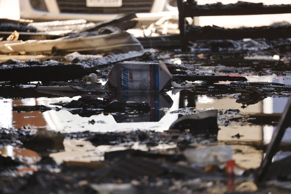 Chared remains in a breezeway are seen following a fire at the Oak Meadows Apartments on Woodmeadow Parkway in Dallas Thursday, September 16, 2021. Of the 24 apartments in the building, 12 sustained damage. The rest were uninhabitable because of water and smoke, Dallas Fire-Rescue spokesperson Jason Evans said. One of the units in the building was not occupied. One resident was taken to a hospital with burns that were not believed to be life-threatening. He was hurt while he was trying to escape the building. The fire happened early Thursday morning.