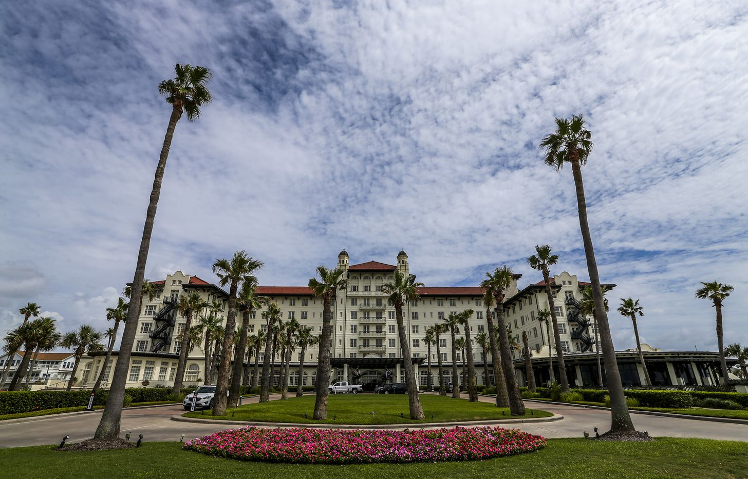 Painters work on the outside of the Grand Galvez hotel on July 15 in Galveston.