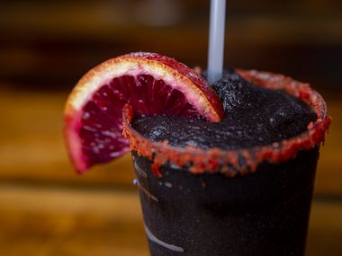 The black frozen margarita at Terry Black's Barbecue in Dallas is made with withtequila, mezcal and triple sec mixed with a jug of secret black margarita mix.