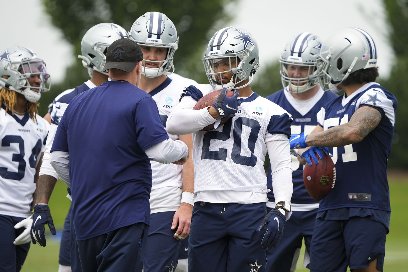 Dallas Cowboys running back Tony Pollard (20) clutches the ball while participating in a fumble drill during a minicamp practice at The Star on Wednesday, June 9, 2021, in Frisco. (Smiley N. Pool/The Dallas Morning News)
