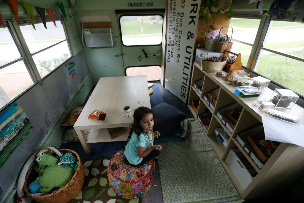 Inez Beltran, 3, eats snacks at Seed Preschool, a mobile school inside a bus, parked at Twelve Hills Nature Center in Dallas. (Jae S. Lee/The Dallas Morning News)