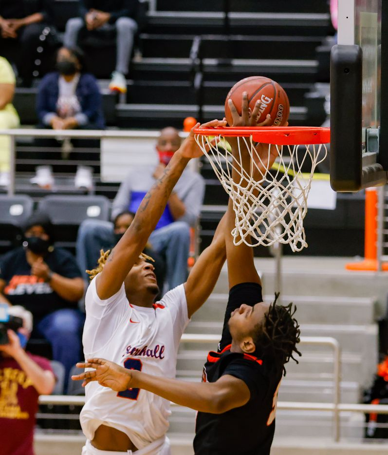 Lancaster's Chrisdon Morgan (33) blocks Kimball's Arterio Morris' (2) shot during the first half of a boys basketball UIL Class 5A Region II playoff game in Forney on Friday, March 5, 2021. (Juan Figueroa/ The Dallas Morning News)