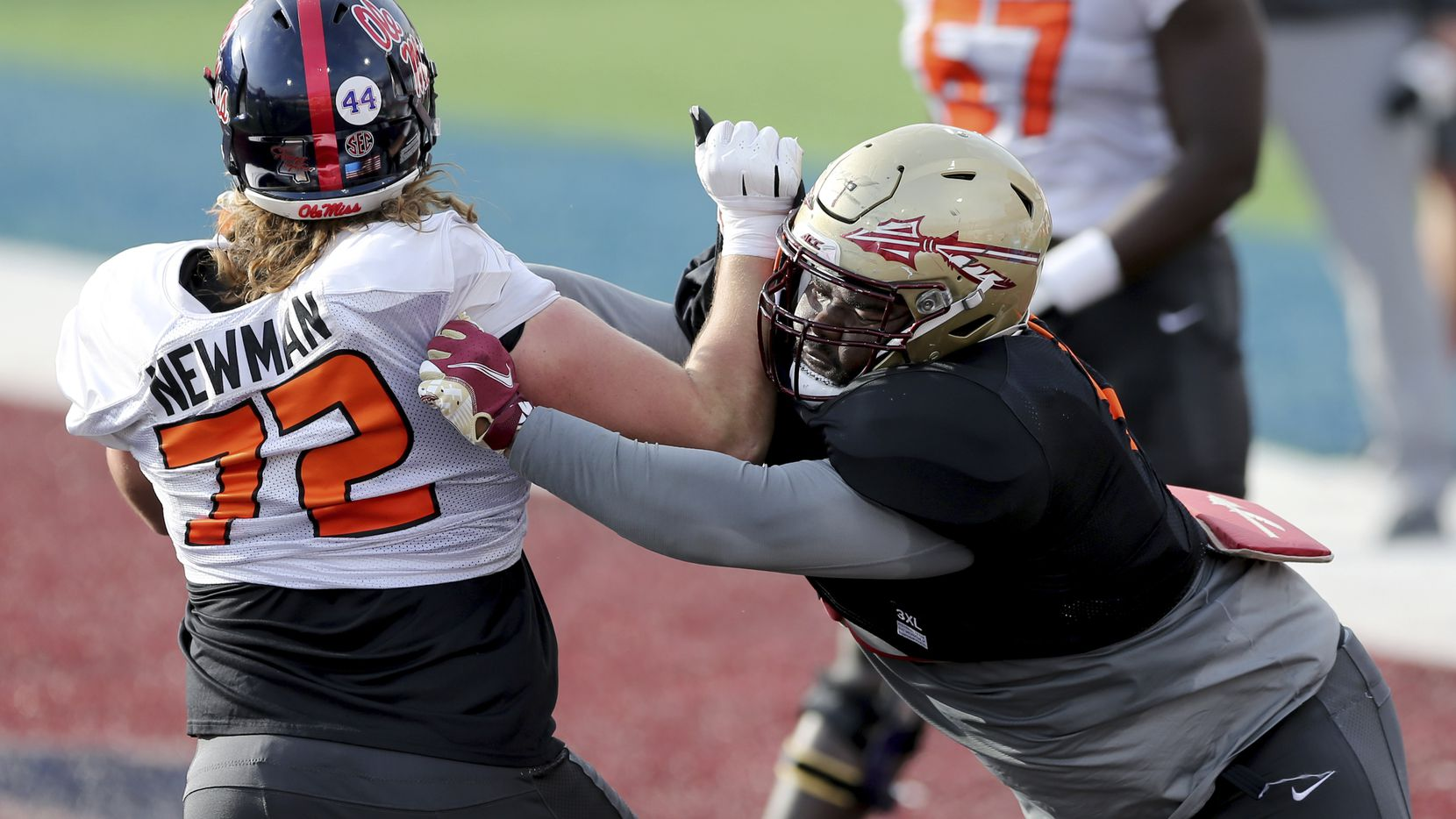Ole Miss offensive lineman Royce Newman (72) and Florida State defensive lineman Marvin Wilson (21) are pictured during a practice for the Senior Bowl game in Mobile, Ala., on Wednesday, Jan. 27, 2021. (AP Photo/Rusty Costanza)
