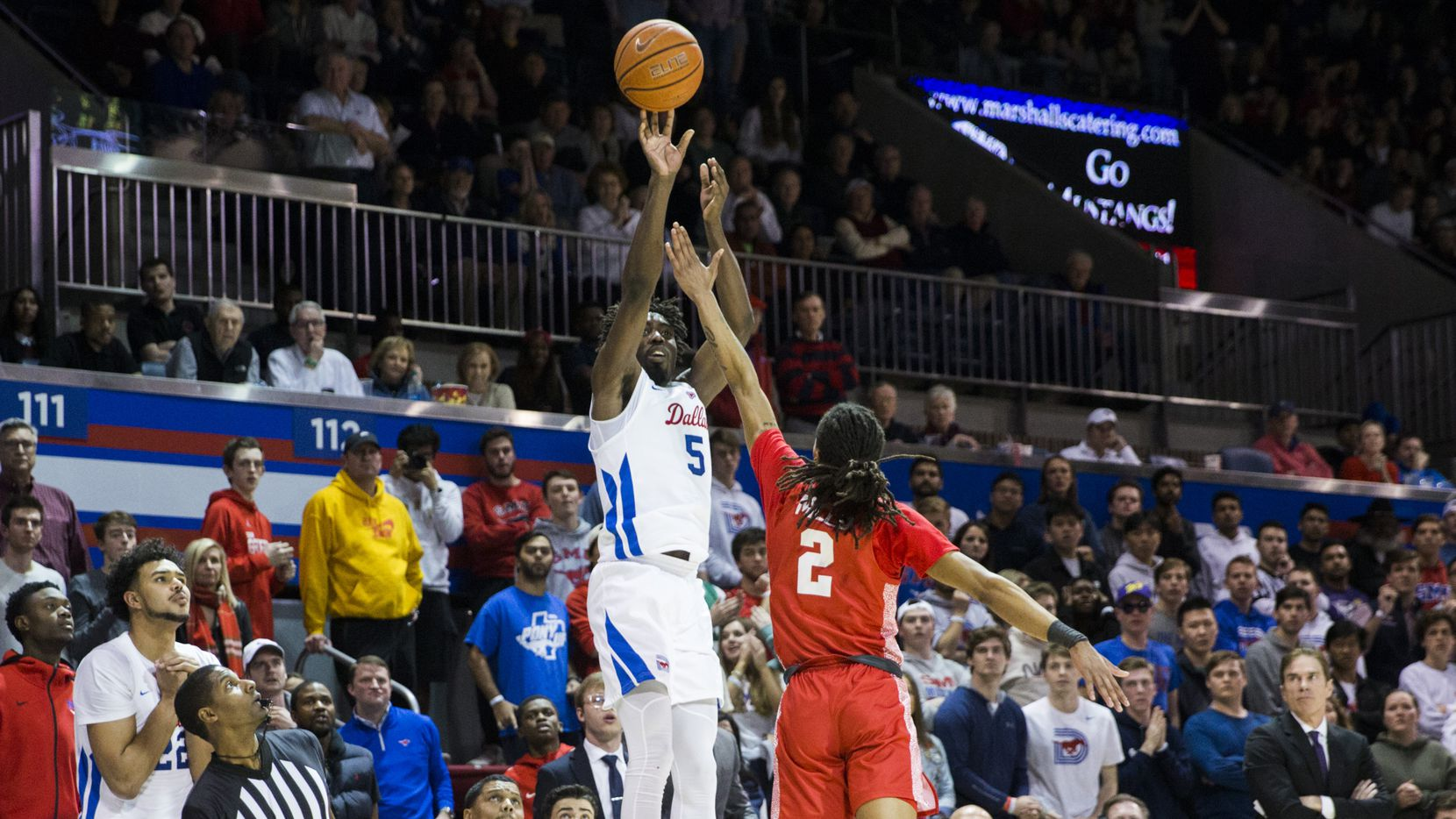 Southern Methodist Mustangs guard Emmanuel Bandoumel (5) makes a three pointer to put SMU up by one point in overtime of a basketball game between SMU and University of Houston on Saturday, February 15, 2020 at Moody Coliseum in Dallas. SMU won 73-72 in overtime. (Ashley Landis/The Dallas Morning News)